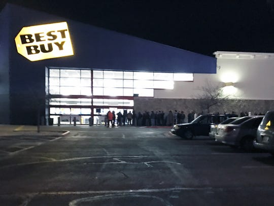 Customers line up before midnight on March 2 for the