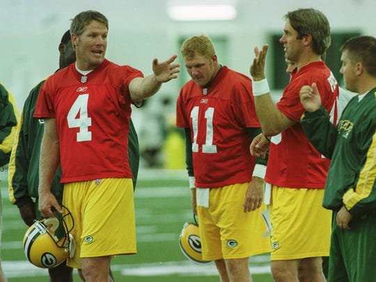 In meetings, Brett Favre entertained himself and his backups with pranks and all kinds of foolishness. He's shown with backups Billy Joe Tolliver (11) and Doug Pederson (18).