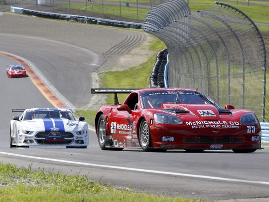 Amy Ruman, in the No. 23 Chevy Corvette, leads Cliff Ebben's Ford Mustang through Turn 9 during the Trans-Am race Sunday at Watkins Glen International.
