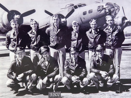 Don Fish stands second from left in the front row in a photo from World War II. The entire crew except Fish perished after being hit by German fire over Merseburg, Germany.