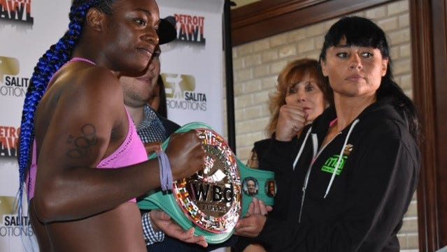 Boxers Claressa Shields, left, and Sydney LeBlanc pose after weighing in on Thursday, June, 15, 2017, a day before their bout  at Detroit's Masonic Temple.