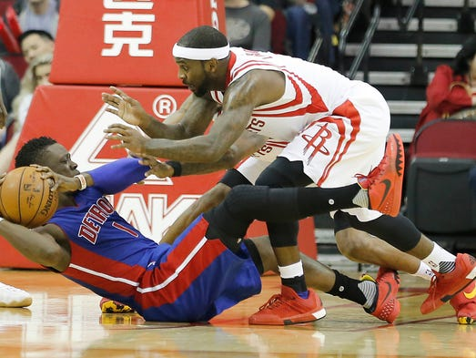 Pistons guard Reggie Jackson (1) is defended by Rockets