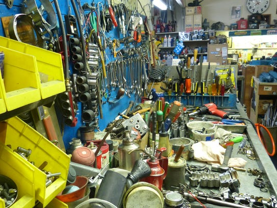 Ed Ewing needs a lot of tools to keep his outboard