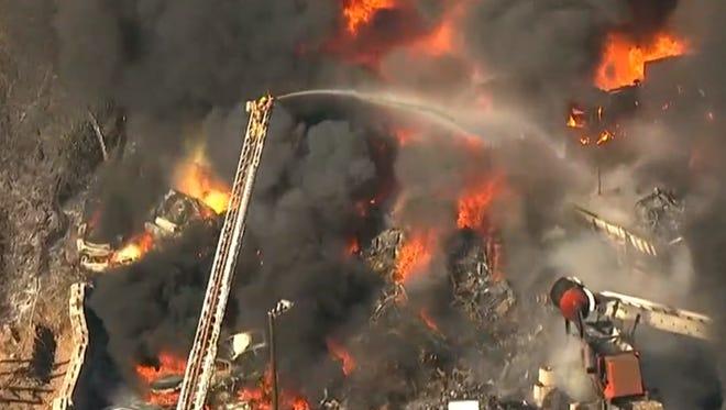 Firefighters douse a blaze in NE Portland on Monday, March 12.