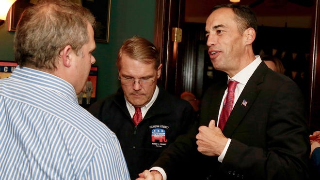 Elmira attorney Chris Baker is greeted with accolades at Bernie Murray's on the Southside Tuesday after winning the Chemung County judge seat. Bernie Murray's was a headquarters of sorts for several Republican candidates seeking re-election to their respective offices.
