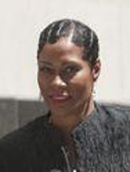 Monica Morgan-Holiefield, right, and defense lawyer