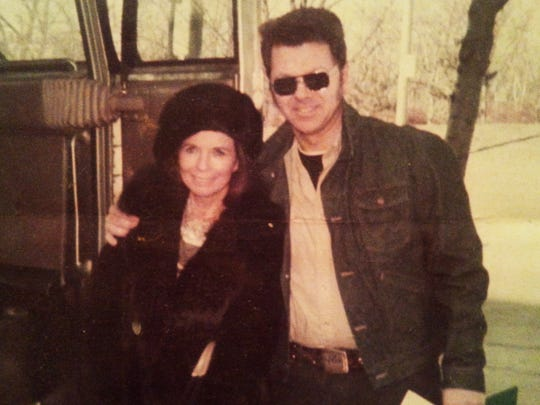 George Richard poses with June Carter Cash following a 1987 concert in Burlington.