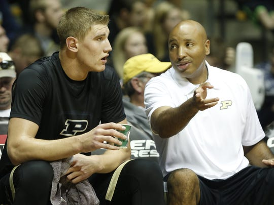 Assistant coach Brandon Brantley with instructions for Isaac Haas as Purdue men's basketball holds its second scrimmage Oct. 25, 2014, in Mackey Arena.