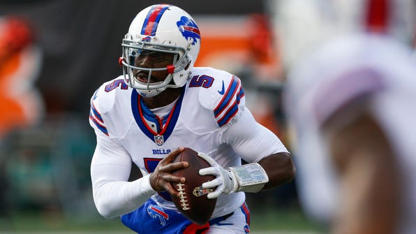 FILE - In this Nov. 20, 2016, file photo, Buffalo Bills quarterback Tyrod Taylor (5) looks to pass on the run in the first half of an NFL football game against the Cincinnati Bengals,  in Cincinnati. Following a four-game swoon, the Pittsburgh Steelers (7-5) are on a roll in having won three straight to move into a tie with Baltimore atop the AFC North in preparing to travel to play the Buffalo Bills (6-6) on Sunday.(AP Photo/Gary Landers, File)