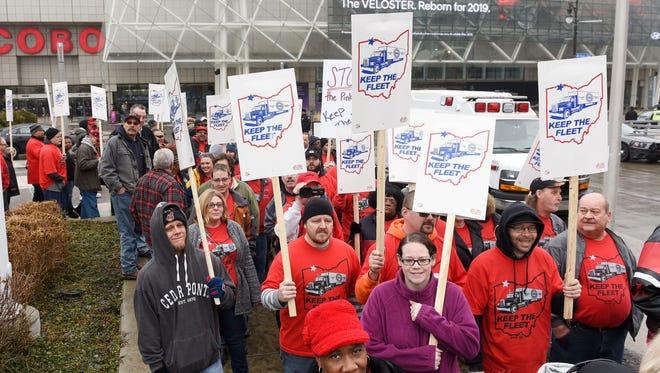 About 300  UAW members and their supporters rallied Sunday on Jefferson Avenue outside Cobo Center, in the shadow of the North American International Auto Show,to protest the layoffs and what they mean for the collective bargaining process.