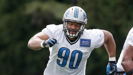Detroit Lions defensive tackle Ndamukong Suh runs a drill during training camp in Allen Park, Mich., on Monday.