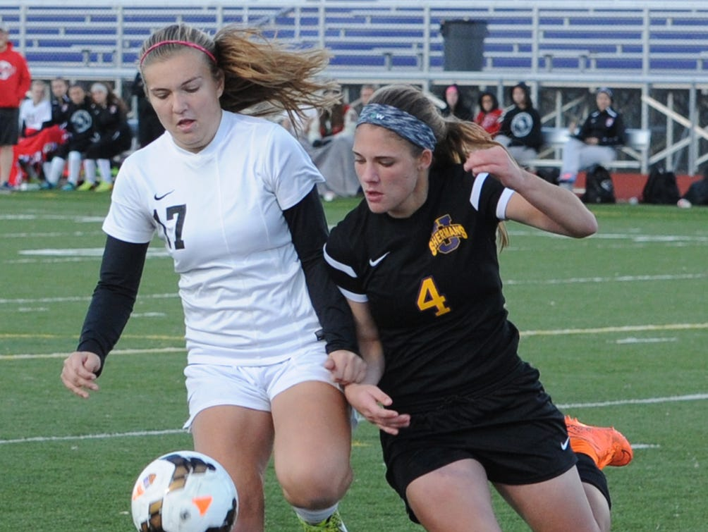 Fairfield Union's Madison Newell battles for possession of the ball with Unioto's Lexi Maughmer Thursday at Logan High School. The Falcons defeated the Shermans 3-1.