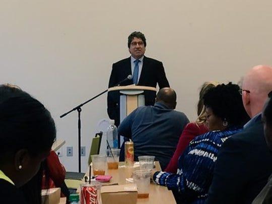 Vanderbilt University Chancellor Nicholas Zeppos addresses the Diversity Nashville Bus Tour participants at Casa Azafrán on Oct. 26, 2015.