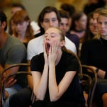 This file photo shows a girl yawning while waiting to take part in the David Jones Autumn Winter 2016 Fashion Launch model casting in Sydney, Australia, 13 January 2016.