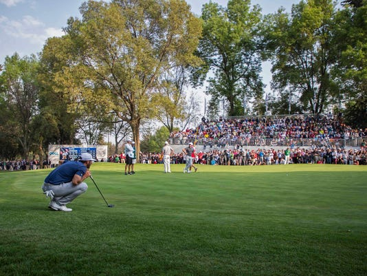 Dustin Johnson, of the United States, watches the ball at the 18th green during the Mexico Championship at Chapultepec Golf Club in Mexico City, Sunday, March 5, 2017. Johnson won the Mexico Championship in his debut as the No. 1 player in the world. (AP Photo/Christian Palma)