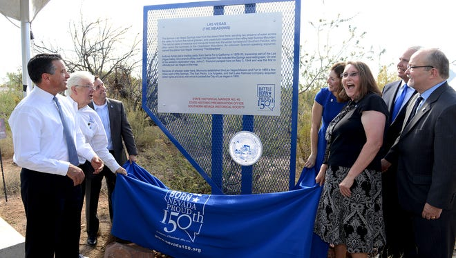 Nevada Gov. Brian Sandoval, left, unveils historical Marker 40 in Las Vegas on Sept. 25.