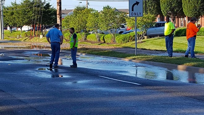 A crew inspects a water main break at 96th Street and Gray Road on Friday.