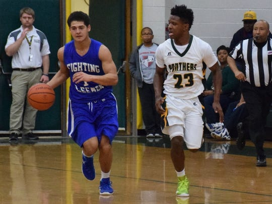 Robert E. Lee's Tavian Brown moves up the court as