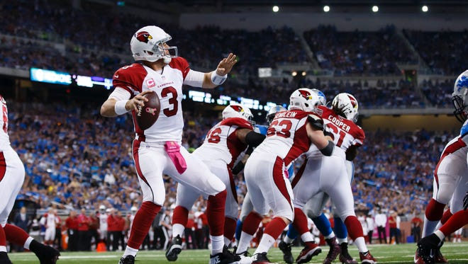 Arizona Cardinals quarterback Carson Palmer (3) passes against the Detroit Lions during an NFL football game at Ford Field in Detroit, Sunday, Oct. 11, 2015.