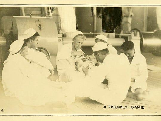 Sailors play cards on the USS Arizona. Courtesy of