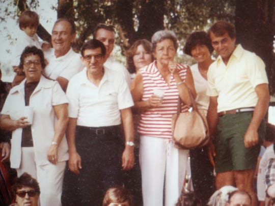 A photo from 1979 of the Boehner family, with John and his wife far right, and his parents, front at left, was partially hidden at Andy's Cafe in Carthage.