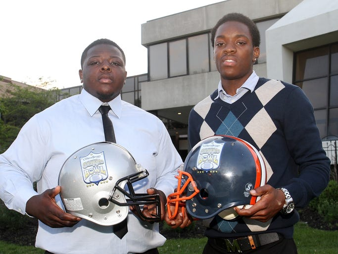 Former Rahway teammates Stephan Watkis-Davis of Rahway and Elijah Williams of Colonia at the press conference for Snapple Bowl XXI, Monday, May 19, 2014, at North Brunswick High School in North Brunswick, NJ.  The pair will be on opposite sides of the ball for The Snapple Bowl.   Photo by Jason Towlen