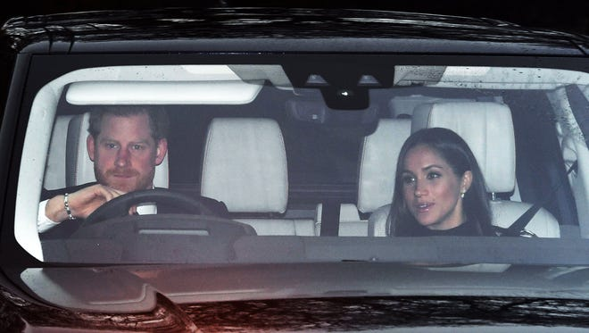 Britain's Prince Harry and his fiancee, Meghan Markle, arrive for the annual Christmas lunch at Buckingham Palace in London on Dec. 20, 2017.