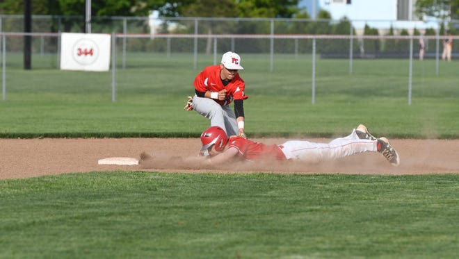 Port Clinton's Braeden George tags a runner out at second base.