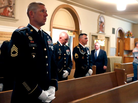 Officers from Fort Leonard Wood stand during the funeral