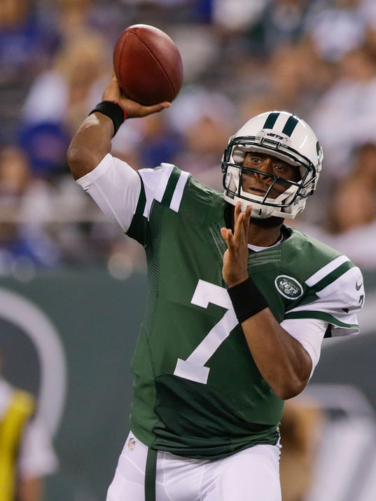 New York Jets quarterback Geno Smith (7) throws against the New York Giants in the first quarter of a preseason NFL football game, Friday, Aug. 22, 2014, in East Rutherford, N.J. (AP Photo/Julio Cortez)