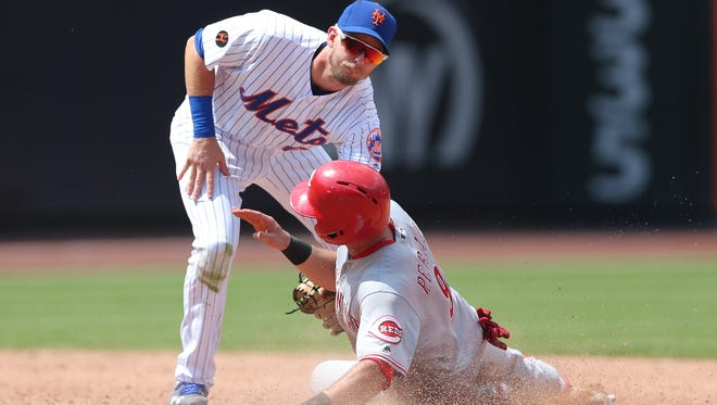 Aug 8, 2018; New York City, NY, USA; New York Mets second baseman Jeff McNeil (68) tags out Cincinnati Reds shortstop Jose Peraza (9) trying to steal second during the sixth inning at Citi Field. Mandatory Credit: Brad Penner-USA TODAY Sports
