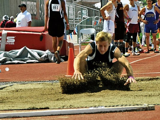 Tell Lowrance, of Capitan High School, leaps 18 feet, 4.75 inches in the Class 3A long jump.