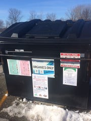 The new organics-only dumpster on the back side of