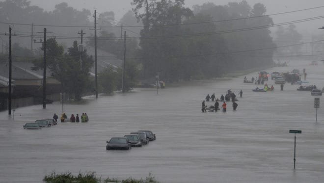 Volunteers rescue Houston residents from rising floodwaters on Monday, Aug. 28, 2017.
