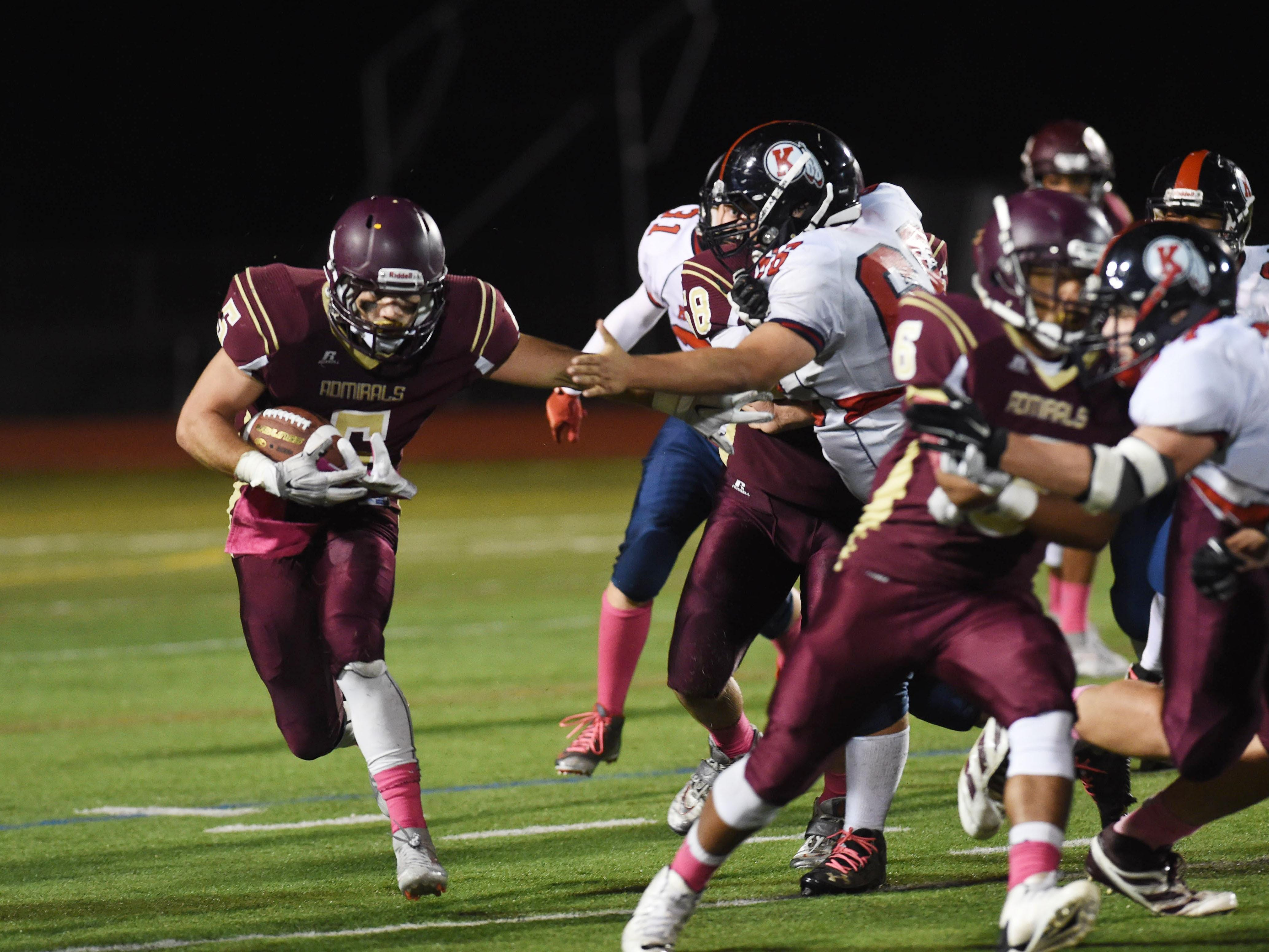 Arlington High School's Rob Tannenbaum shakes off a Roy C. Ketcham tackler on Friday in Freedom Plains.