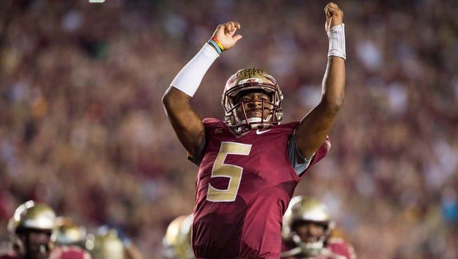 Florida State Seminoles quarterback Jameis Winston (5) celebrates after defeating the Notre Dame Fighting Irish 31-27 at Doak Campbell Stadium.