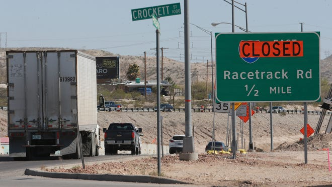 A sign Thursday advises motorists of the closure of Racetrack Road.