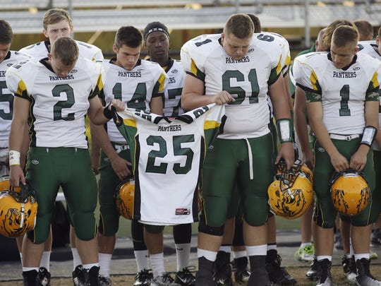 Little Miami football team observes a moment of silence