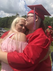 Emily Milam, 18, hugs her mom, Gloria Milam after graduating.