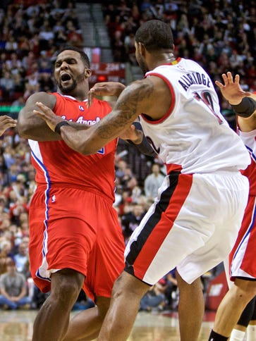 Los Angeles Clippers forward Glen Davis is pushed by