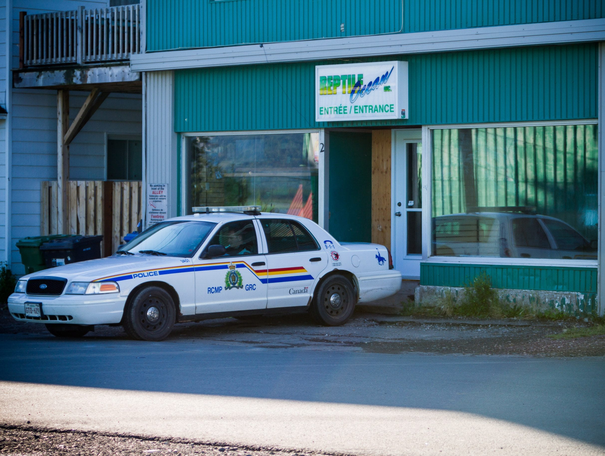 In this 2013 photo, a Royal Canadian Mounted Police cruiser sits outside the Reptile Ocean exotic pet store in Campbellton, New Brunswick, Canada.