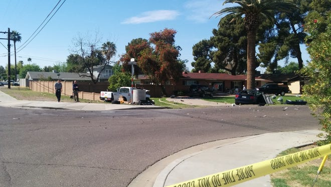 A mustang crashed into a truck, which then hit a wall and a landscape worker.