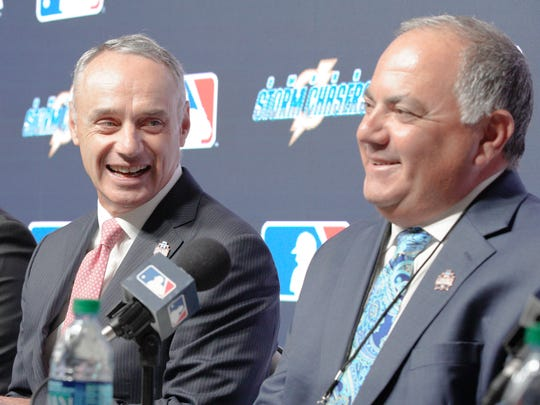 MLB commissioner Rob Manfred, left, and Al Avila, general manager of the Detroit Tigers, participate in a news conference in Omaha, Neb., June 21, 2018.