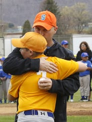 Zack Brown hugs son Michael after throwing out the