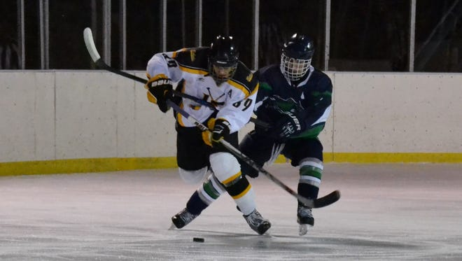 A.J. Cappello breaks out during a 7-6 overtime loss to Mount Pleasant on Tuesday at Brewster Ice Arena's outdoor rink.
