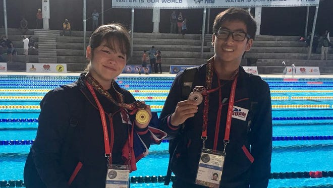 Mineri Gomez, left, took gold and Mark Imazu finished with a bronze in the 5K ocean swim at the Oceania Swimming Championships in Papua New Guinea on June 26.