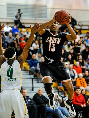 Linden's Tavon Jones (13) soars to the basket against the Patrick School's Jamir Harris on Tuesday at Kean University.