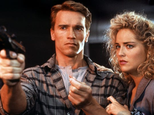 "Arnold Schwarzenegger and Sharon Stone star in ""Total Recall."" It's from 1990, as the hairstyles will tell you."