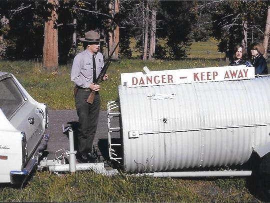Jerry Mernin stands by a bear trap in Yellowstone National Park's Canyon area in the mid-1960s.