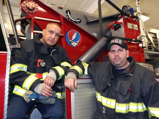 Port Chester Volunteer Firefighter Anthony Torres and Capt. Larry Miano, are pictured next to the tower ladder turntable, with a Grateful Dead logo, on the Harry Howard Hook & Ladder Co. #1 on Westchester Avenue in Port Chester, April 6, 2016.